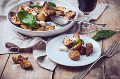 Homemade rustic dinner: a glass of wine and a baked potato Royalty Free Stock Images