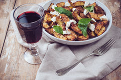 Homemade rustic dinner: a glass of wine and a baked potato Stock Photos