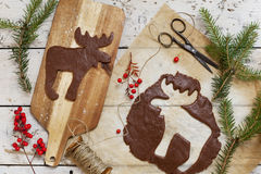Homemade rustic gingerbread elk shaped cookie for Christmas Stock Images