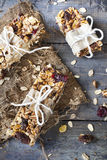 Homemade rustic granola bars with dried fruits and handmade packaged Royalty Free Stock Photo