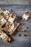 Homemade rustic granola bars with dried fruits and handmade packaged Royalty Free Stock Image