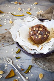 Homemade rustic muffin with pumpkin chocolate and oat flakes on bowl with burnt greasproof paper Stock Photos