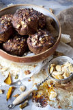 Homemade rustic muffins with pumpkin chocolate and oat flakes on big bowl Stock Photography