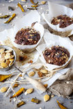 Homemade rustic muffins with pumpkin chocolate and oat flakes packaged with greasproof paper Stock Photos