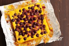 Homemade rustic quark pie with cherries baked in foil Stock Photography