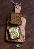 Homemade rye bread and lemon, basil, ricotta and honey bruschetta on a brown wooden table. Royalty Free Stock Images