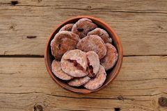 Homemade rye cookies with berries in clay bowl Stock Image