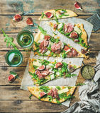 Homemade sage flatbread pizza cut into pieces with rose wine Royalty Free Stock Images