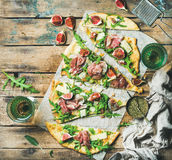 Homemade sage flatbread pizza with rose wine in glasses Stock Images