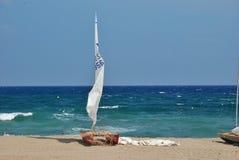 Homemade sailing catamaran on the beach of the Mediterranean sea, Barcelona Royalty Free Stock Photography