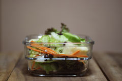 Homemade salad. In a clear square glass bowl Stock Photos