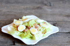 Homemade salad with fresh cabbage, boiled quail eggs and canned tuna Royalty Free Stock Image