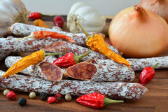 Homemade salametti  with spices and vegetables Royalty Free Stock Image