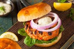 Homemade Salmon Burger with Tartar Sauce Royalty Free Stock Photography
