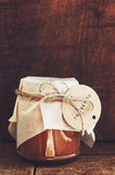 Homemade salted caramel sauce in glass jar with empty space Royalty Free Stock Photos