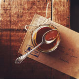 Homemade salted caramel sauce in glass jar on wooden background Stock Photography