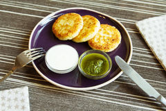 Homemade Salty Cheese Pancakes. With sauce Pesto. Cheesecake pancakes with sour cream. Pancakes photographed close Royalty Free Stock Photography