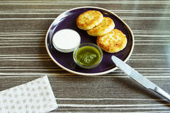 Homemade Salty Cheese Pancakes. With sauce Pesto. Cheesecake pancakes with sour cream. Pancakes photographed close Stock Image