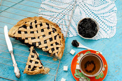 Homemade sand cake with cherry jam on a lattice and a cup of tea Stock Image