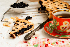 Homemade sand cake with cherry jam on a lattice and a cup of tea Royalty Free Stock Photography