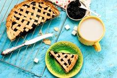 Homemade sand cake with cherry jam on a lattice and a cup of tea Stock Photos