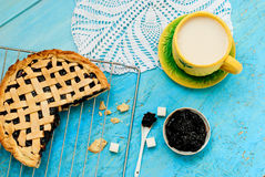 Homemade sand cake with cherry jam on a lattice and a cup of tea Royalty Free Stock Photos