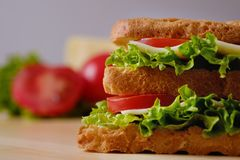 Homemade appetizing sandwich on a wooden board, close-up stock photo