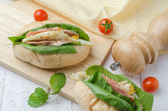 Homemade sandwich with ham, eggs, cheese and vegetables on white. Wooden table background Stock Photography