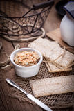 Homemade sandwiches with crisp bread, tuna and egg on a wooden t Stock Image