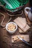 Homemade sandwiches with crisp bread, tuna and egg on a wooden t Stock Photos