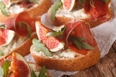 Homemade sandwiches with figs, ham, arugula and cream cheese clo Royalty Free Stock Photography