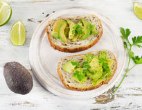 Homemade sandwiches  with a fresh sliced avocado Stock Photography