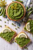 Homemade sandwiches with green peas close-up. vertical top view Royalty Free Stock Photography