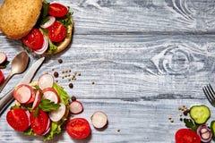 Homemade sandwiches with tomato, onion, radishes, parsley Stock Image