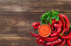 Homemade sauce and red hot chili peppers and celery Royalty Free Stock Image