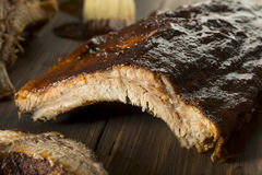 Homemade Saucy Baked Baby Back Ribs. Ready to Eat Royalty Free Stock Photos