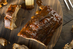 Homemade Saucy Baked Baby Back Ribs. Ready to Eat Royalty Free Stock Photography