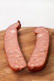 Homemade sausage cut for frying Stock Photography