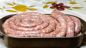 Homemade sausage in metallic tray Stock Photo