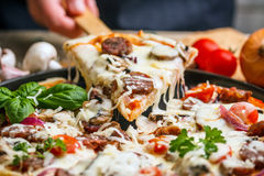 Homemade sausage pizza Royalty Free Stock Images