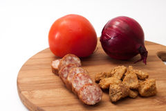 Homemade sausage and pork scratchings served with tomatoes and o stock photos