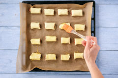 Homemade sausage rolls on wooden background. Royalty Free Stock Photo