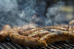 Homemade sausages on barbeque Royalty Free Stock Photos