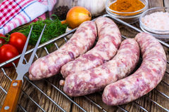 Homemade sausages in a natural shell with spices on grill. Studio Photo Stock Images