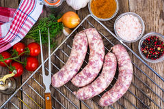 Homemade sausages in a natural shell with spices on grill. Studio Photo Royalty Free Stock Image