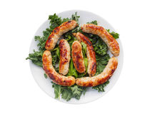 Homemade sausages on the plate with kale Royalty Free Stock Photo