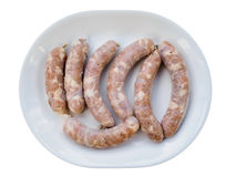 Homemade sausages raw on the plate Stock Photos
