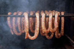 Homemade sausages in a traditional smoker. Smoked sausage in Smokers Stock Photography