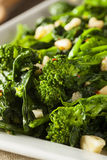 Homemade Sauteed Green Broccoli Rabe. With Garlic and Nuts Royalty Free Stock Photo