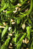 Homemade Sauteed Green Broccoli Rabe. With Garlic and Nuts Stock Photography